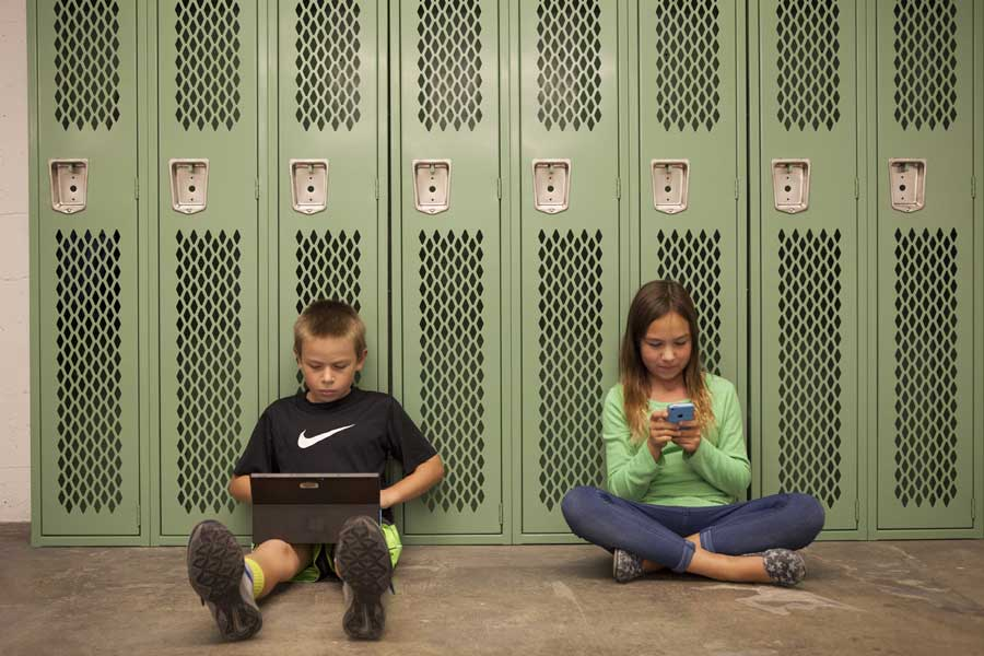 students on devices at school