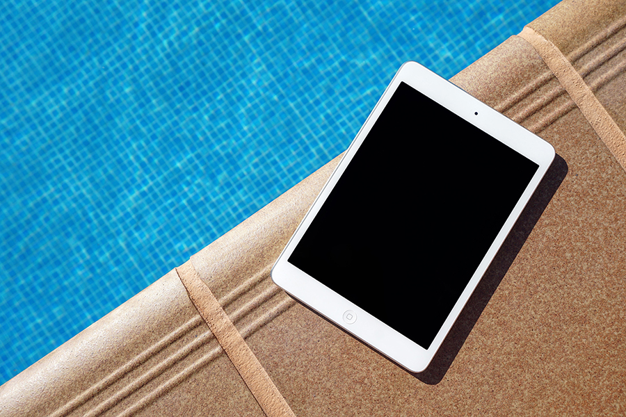 Image of iPad by pool for remote learning