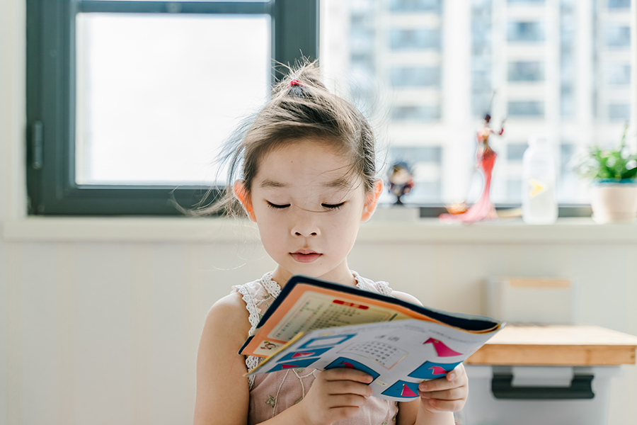image of young girl reading